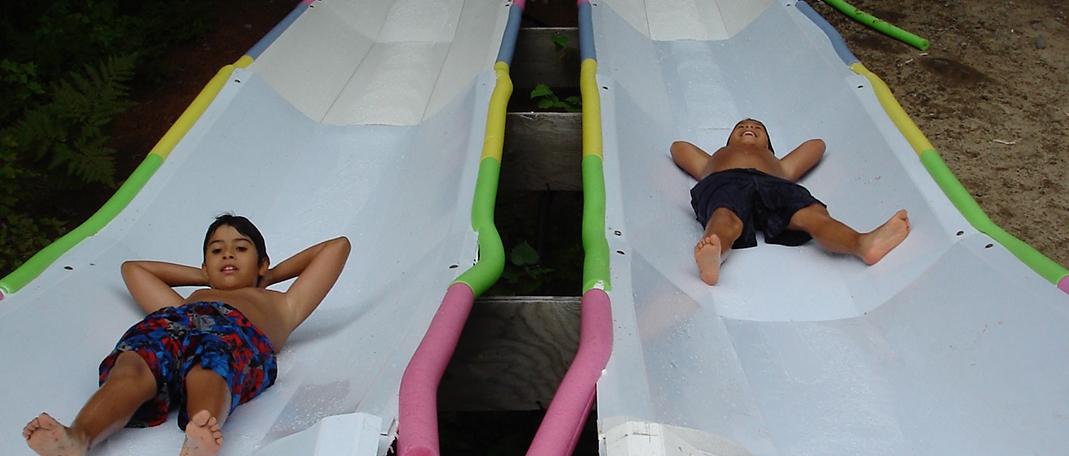 Glissades d'eau - Activités- Camp de vacances et de plein air quatre saisons - Boute-en-Train